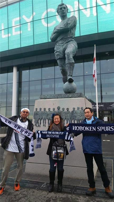 L.A. Spurs Shubes, Ellie and Mark with the exchanged scarves at Bobby Moore Statue, Wembley on Boxing Day